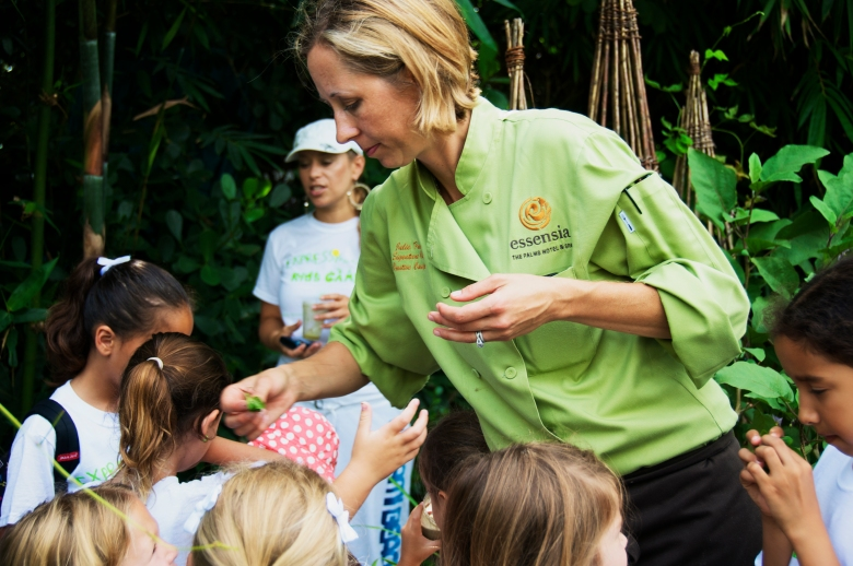 Chef Julie letting the children smell herbs from her garden