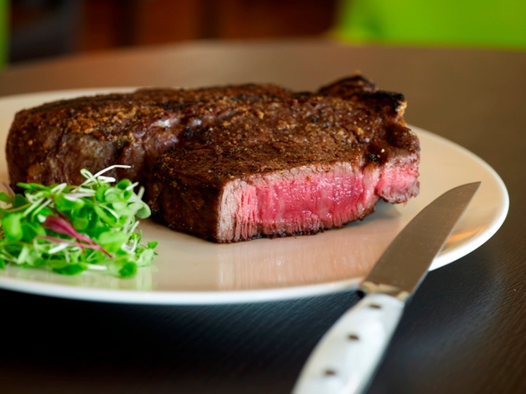 rare steak with knife