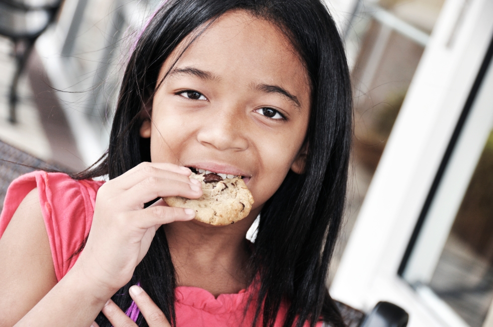 girl eating a cookie
