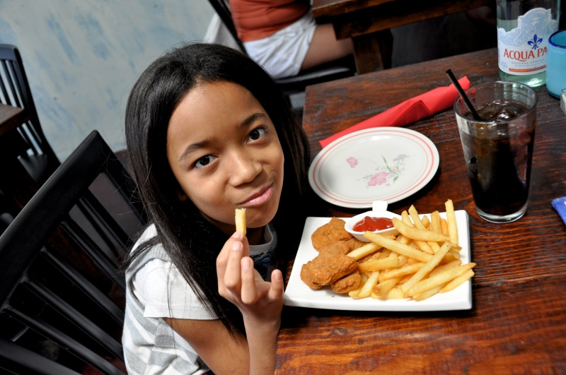 girl eating chicken fingers