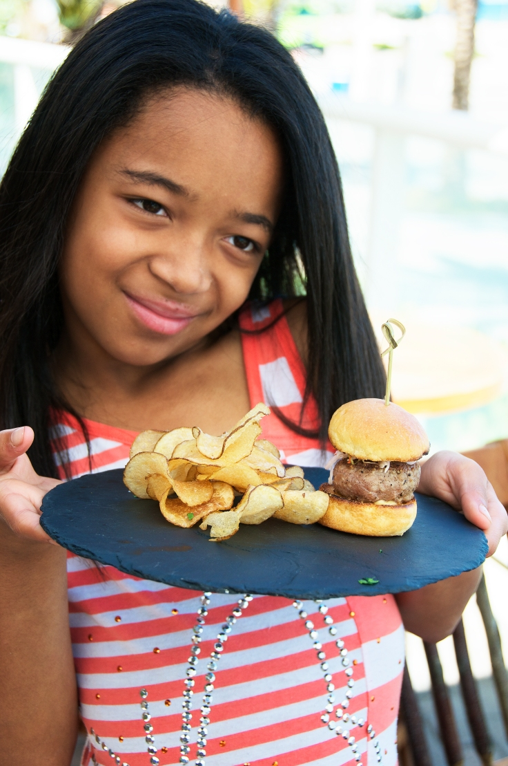 girl holding duck sliders