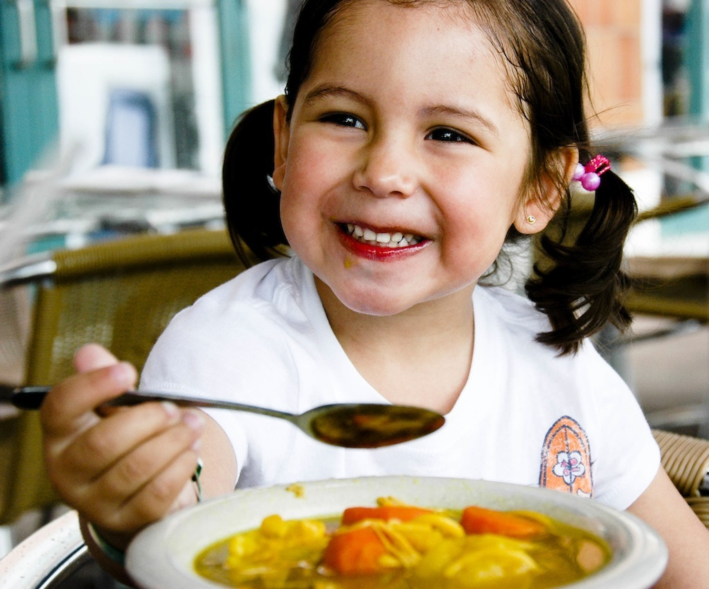 girl eating chicken soup