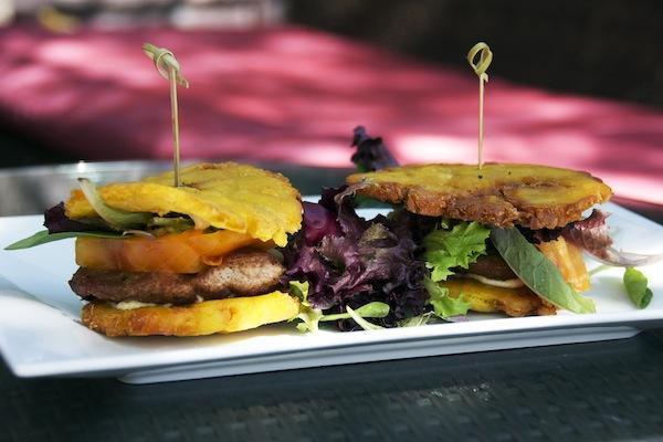 Jibarito Sliders – Pork Tenderloin, tostones, romaine lettuce, tomato, cumin cilantro aioli