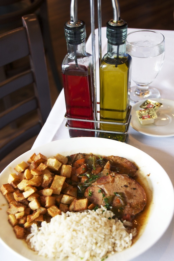 Roasted Veal served with fried potatoes and rice