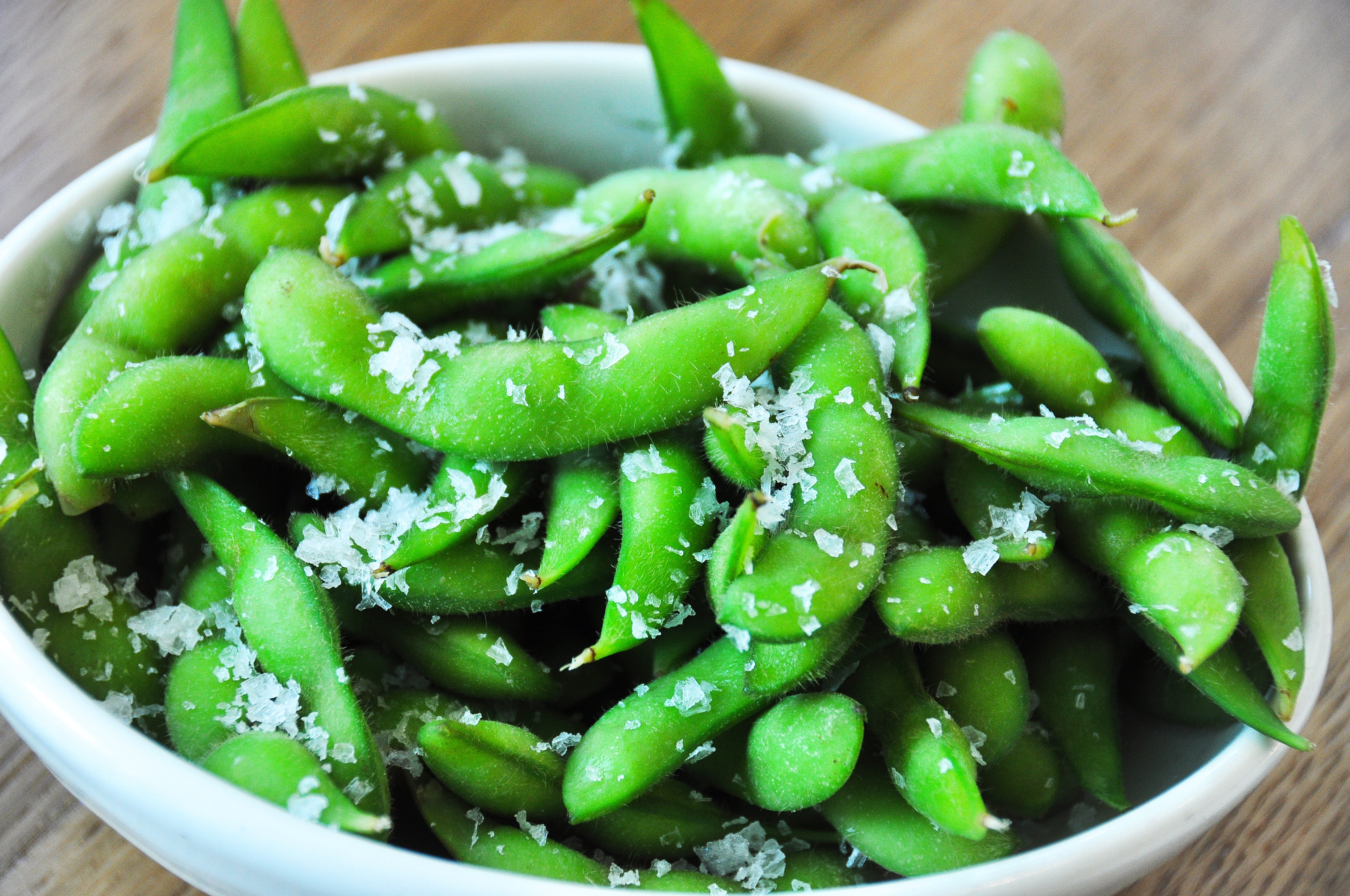 Edamame are green soybeans the pods are boiled or steamed and served