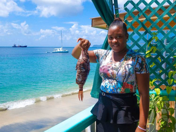 holding the lionfish