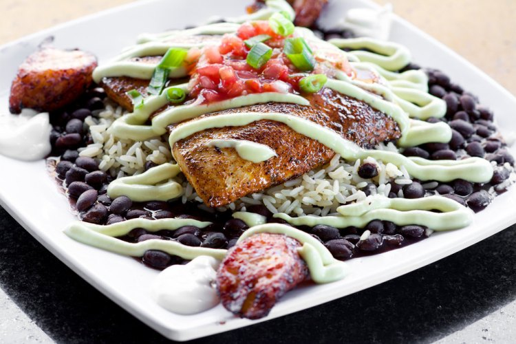 Blackened Dolphin Avocado served with black beans, rice and our cilantro avocado cream topped with fresh salsa