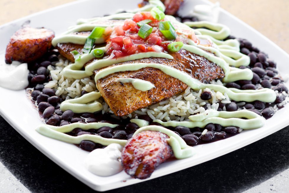 Blackened Dolphin Avocadoserved with black beans, rice and our cilantro avocado cream topped with fresh salsa