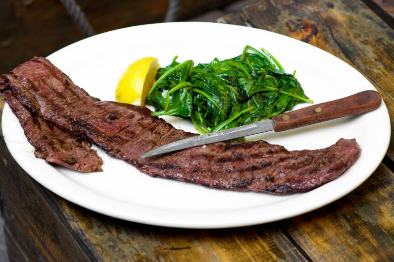 All Natural Grass Fed Skirt Steak served with Sautéed Spinach With Garlic And Lemon