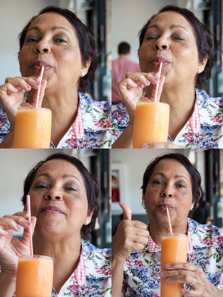 Ms. G. enjoying her Mango, strawberry and passion fruit juice